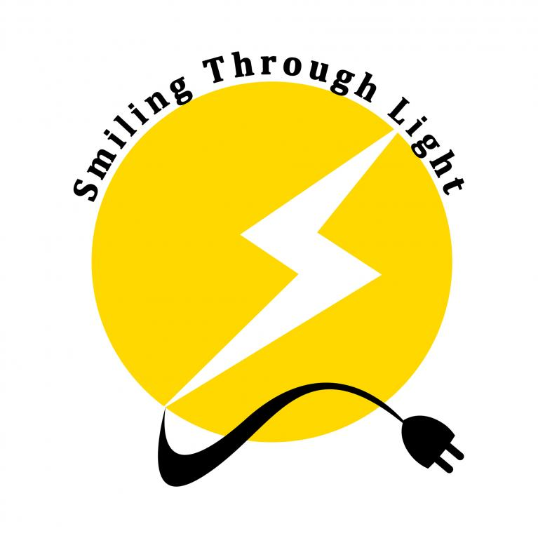 Smiling Through Light Logo.jpg